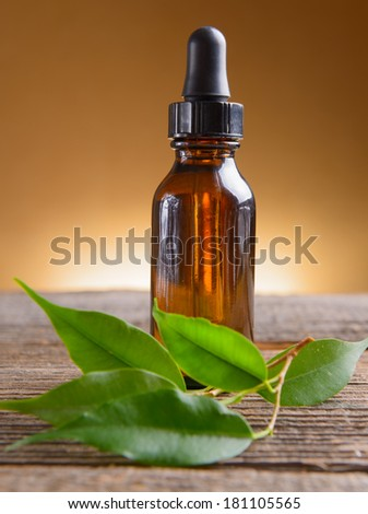 Pure organic essential oil in amber glass bottle - stock photo