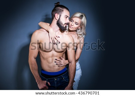 Pure passion. Closeup of undressed sensual pair. Young lady embracing man with beautiful muscular torso - stock photo
