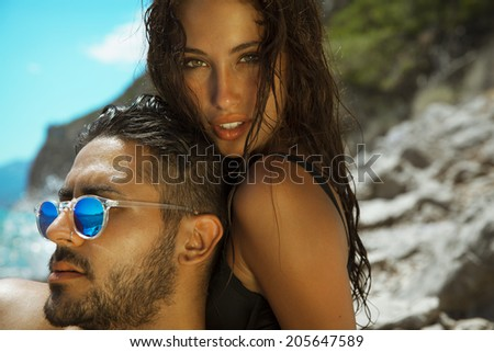 Pure passion . Shot on the beach. Horizontal , outdoors - stock photo