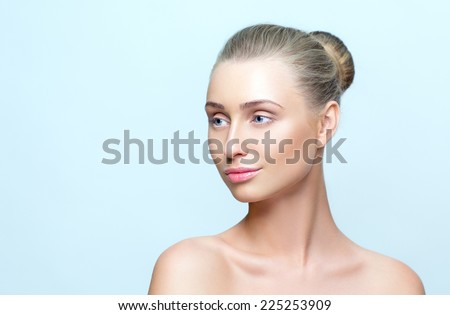 Pure portrait of woman with perfect skin and natural make up - stock photo