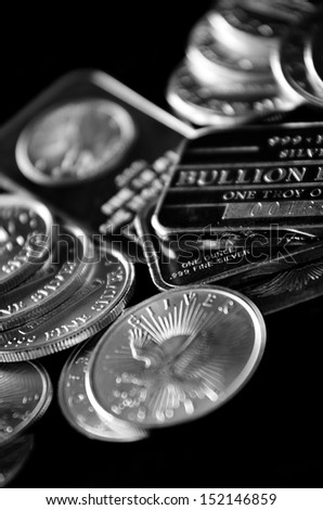 Pure silver coins and bars bullion - stock photo