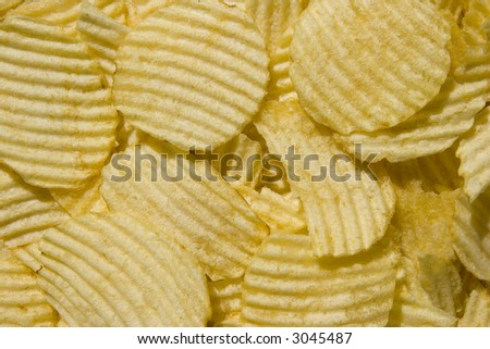 Pure Sunflower Oil Potato Chips Background - stock photo