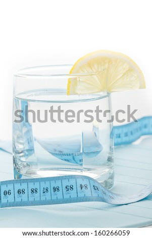 Pure water for healthy life with measure tape - stock photo