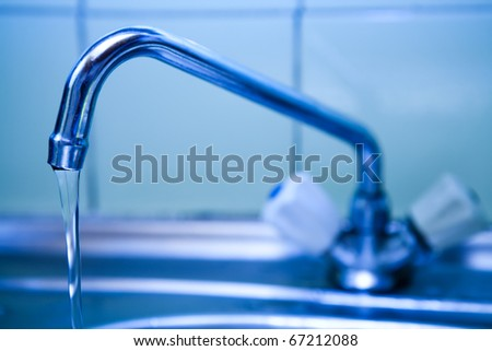 pure water which flows from the crane on kitchen - stock photo