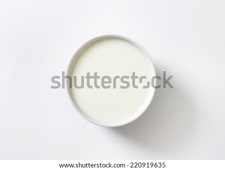 pure white view of bowl with milk - stock photo