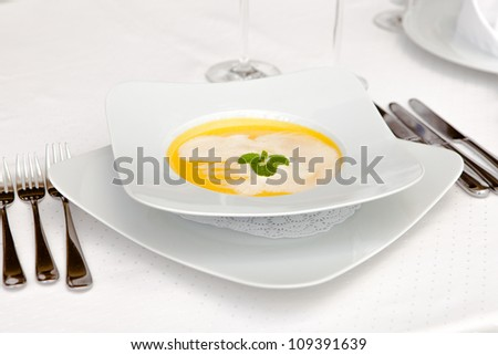 Puree soup in a bowl with the devices