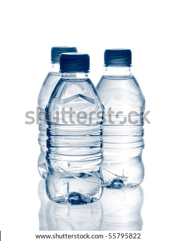 purified spring mineral water in the bottles with reflection. Is not isolated - stock photo