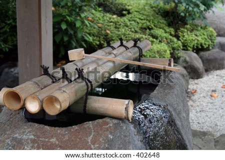 Purifying water receptacle at a Buddhist Temple in the outskirts of Tokyo, Japan. - stock photo