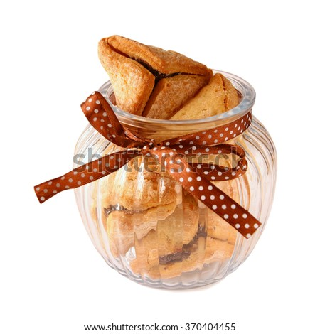 Purim celebration cookies (jewish carnival holiday). selective focus. isolated on white - stock photo