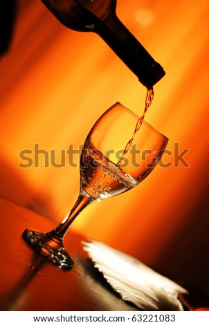 puring a glass of wine - stock photo
