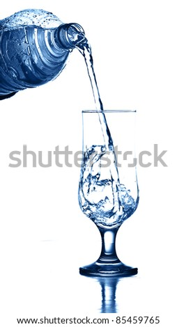 puring fresh water on glass on white background - stock photo