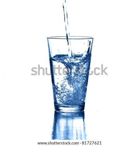 puring water on a glass on white background - stock photo