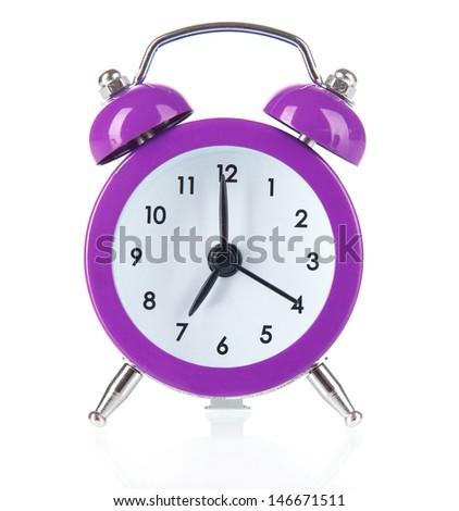 Purple alarm clock isolated on white - stock photo