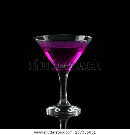 Purple alcoholic cocktail in a glass on black - stock photo
