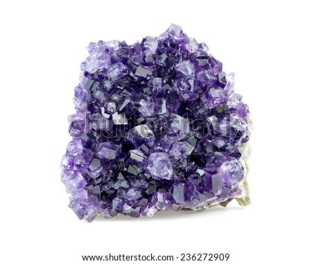 Purple amethyst geode on white background - stock photo