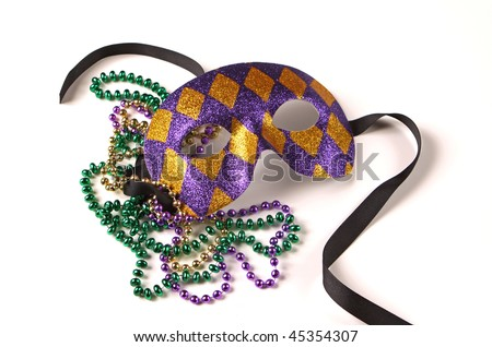 Purple and gold Venetian Mask with green, gold, and purple Mardi Gras beads - stock photo