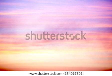 purple and orange clouds during sunset - stock photo