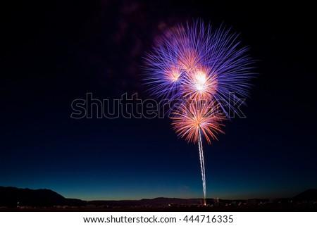 Purple and Orange Fireworks Bursts for a July 4th Celebration - stock photo