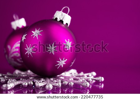 Purple and silver christmas ornaments on dark purple xmas background with space for text - stock photo