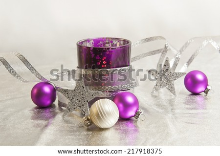 purple and silver storm lamps with Christmas balls - stock photo