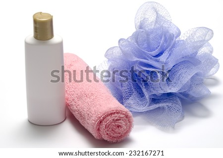 purple bath puff liquid soap and pink towel on a white background - stock photo