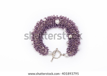 Purple beaded bracelet isolated - stock photo