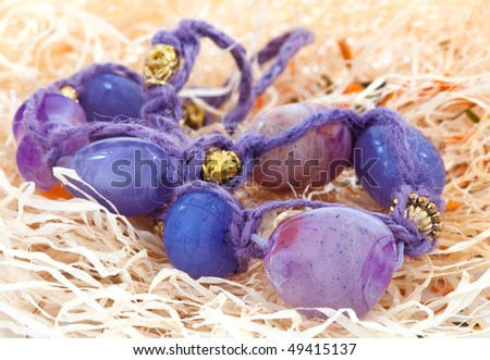 Purple beads. Jewelry. Clouse up. Selective focus