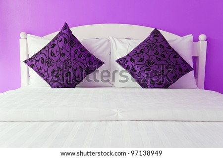 Purple bedroom in a modern house - home interiors. - stock photo