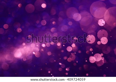 Purple bokeh abstract background caused by spray water. - stock photo