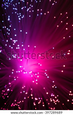 Purple Bokeh from defocused lights from a fiber optic lamp - stock photo