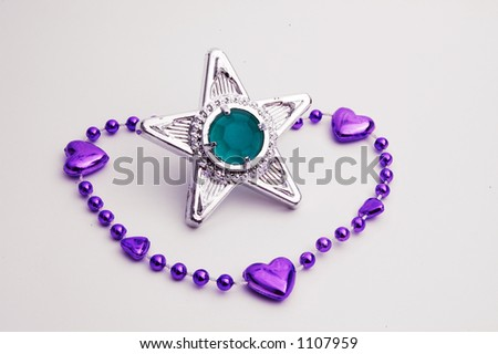 Purple bracelet with a star gem - stock photo
