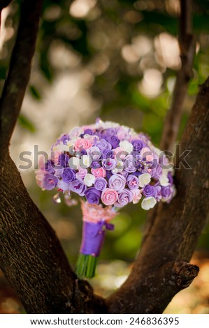 Purple bridal bouquet - stock photo