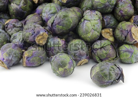 purple brussel sprouts on a white background - stock photo
