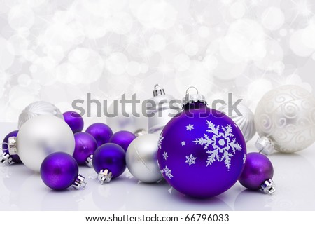 Purple christmas balls on a sparkle background, christmas time