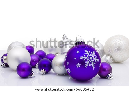Purple christmas balls on a white background, christmas time