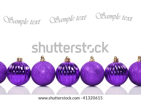 Purple christmas baubles on a white background with space for text - stock photo