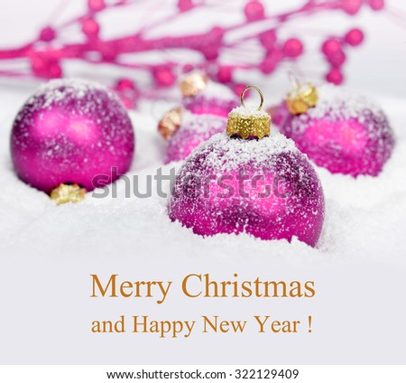Purple Christmas decorations in snow. Merry Christmas card.