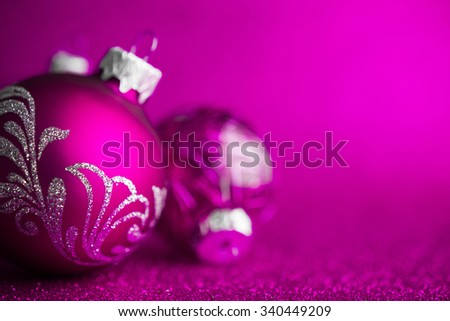 Purple christmas ornaments on dark purple glitter background with space for text. Merry christmas card. Winter holidays. Xmas theme. Happy New Year. - stock photo