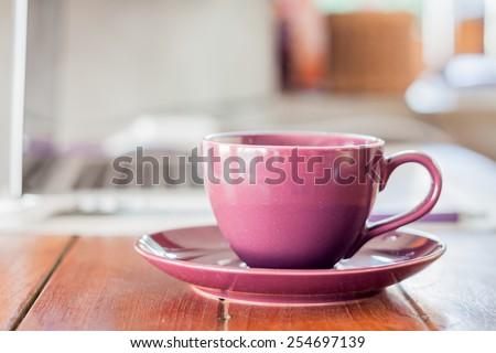 Purple coffee cup on work station, stock photo - stock photo
