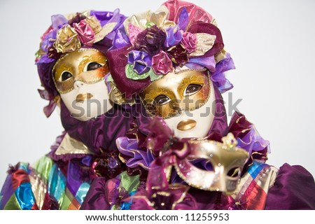 Purple costume with roses at the Venice Carnival