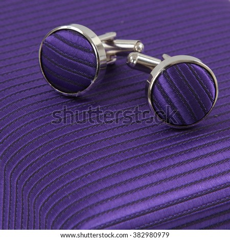 purple cufflinks - stock photo