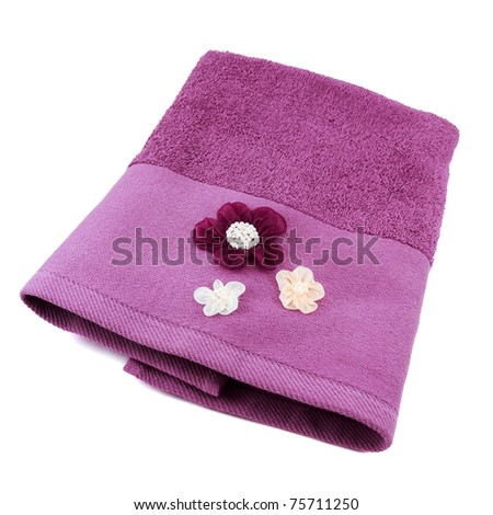 Purple decorated terry towel isolated on white background - stock photo