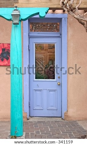 Purple door in a courtyard in Santa Fe, NM. - stock photo