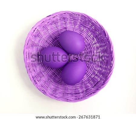 Purple eggs in basket from top view - stock photo