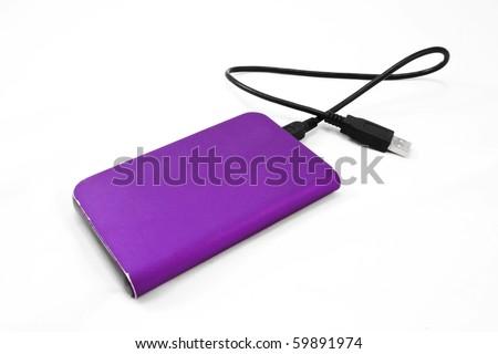 Purple external hard disk - stock photo