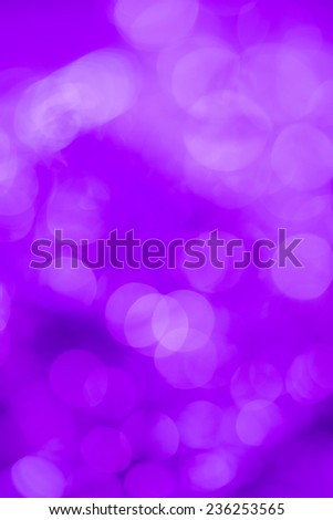 Purple extravagant background. Abstract with bright twinkles, sparkles, blurred, defocused light. - stock photo