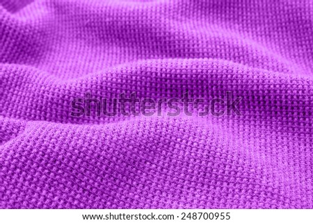 Purple fabric as the background. - stock photo