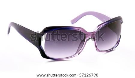 Purple feminine sunglasses - stock photo