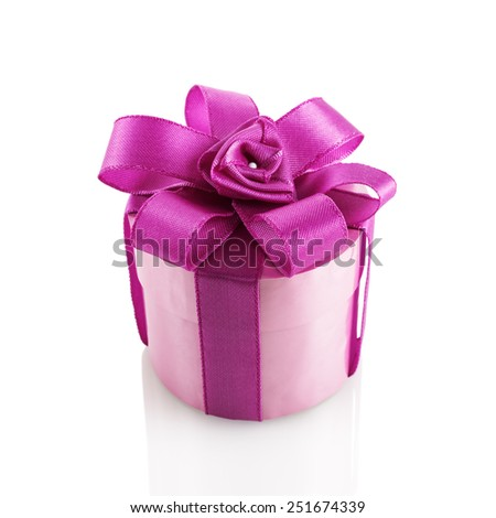 Purple festive gift box with ribbon and bow on a white background. Isolated with clipping path. - stock photo