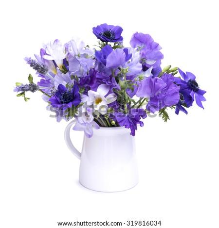 Purple flower bouquet white jug on stock photo royalty free purple flower bouquet in a white jug on white background mightylinksfo